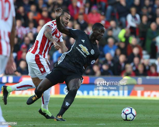 Eric Bailly of Manchester United in action with Jese of Stoke City during the Premier League match between Stoke City and Manchester United at Bet365...