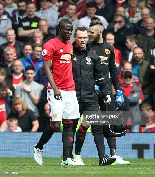 Eric Bailly of Manchester United leaves the match injured during the Premier League match between Manchester United and Swansea City at Old Trafford...