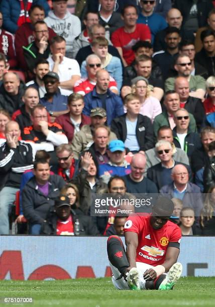 Eric Bailly of Manchester United lies injured during the Premier League match between Manchester United and Swansea City at Old Trafford on April 30...