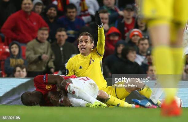 Eric Bailly of Manchester United lies injured during the UEFA Europa League Round of 16 second leg match between Manchester United and FK Rostov at...