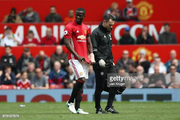 Eric Bailly of Manchester United looks dejected as he is forced off injured during the Premier League match between Manchester United and Swansea...