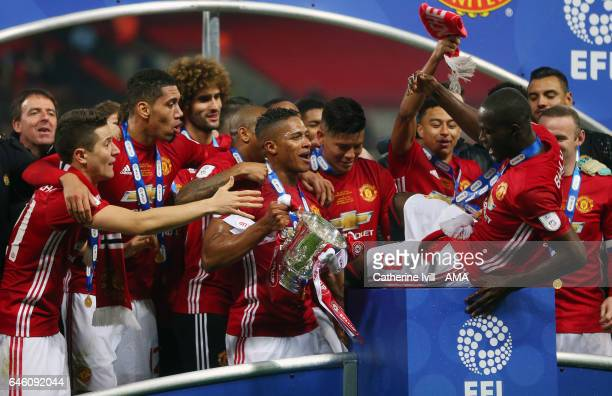 Eric Bailly of Manchester United nearly falls of the podium as he celebrates with his team mates during the EFL Cup Final match between Manchester...