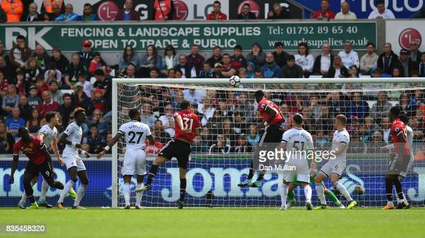 Eric Bailly of Manchester United scores his sides first goal during the Premier League match between Swansea City and Manchester United at Liberty...