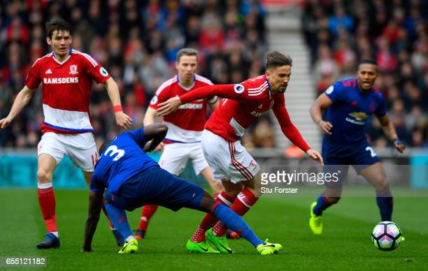 Eric Bailly of Manchester United tackles Gaston Ramirez of Middlesbrough during the Premier League match between Middlesbrough and Manchester United...