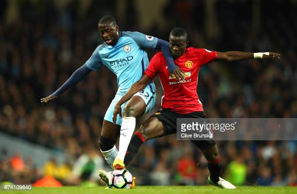 Eric Bailly of Manchester United tackles Yaya Toure of Manchester City during the Premier League match between Manchester City and Manchester United...
