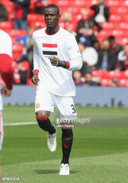 Eric Bailly of Manchester United warms up ahead of the Premier League match between Manchester United and Swansea City at Old Trafford on April 30...