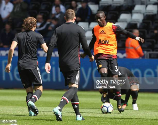 Eric Bailly of Manchester United warms up ahead of the Premier League match between Swansea City and Manchester United at Liberty Stadium on August...