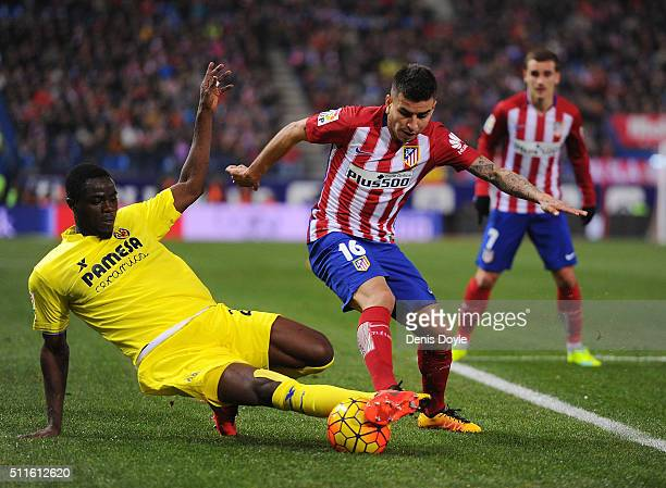 Eric Bailly of Villarreal CF takes the ball from Angel Correa of Club Atletico de Madrid during the La Liga match between Club Atletico de Madrid and...