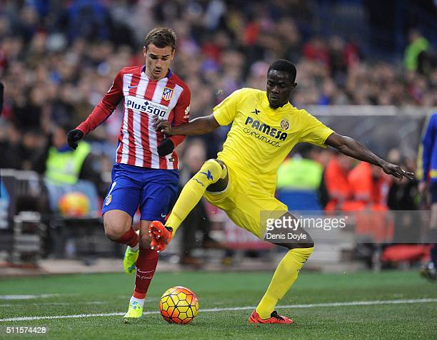 Eric Bailly of Villarreal CF takes the ball from Antoine Greizmann of Club Atletico de Madrid during the La Liga match between Club Atletico de...