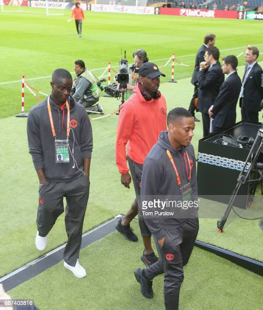 Eric Bailly Paul Pogba and Anthony Martial of Manchester United leave after a walk on the pitch ahead of the UEFA Europa League Final at Friends...