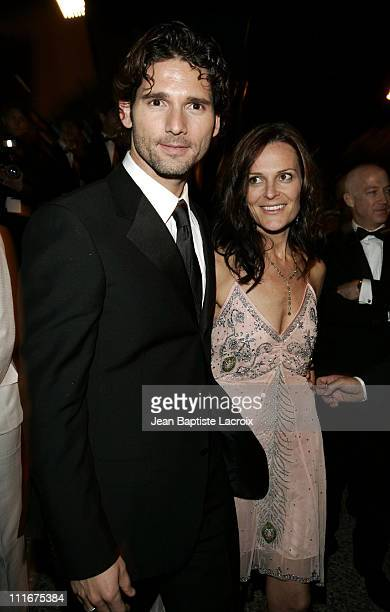Eric Bana and guest during 2004 Cannes Film Festival 'Troy' Premiere Departures at Palais Du Festival in Cannes France