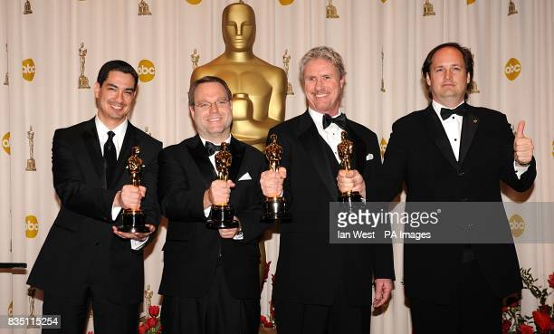 Eric Barba Steve Preeg Burt Dalton and Craig Barron with the Achievement in Visual Effects award received for The Curious Case of Benjamin Button at...