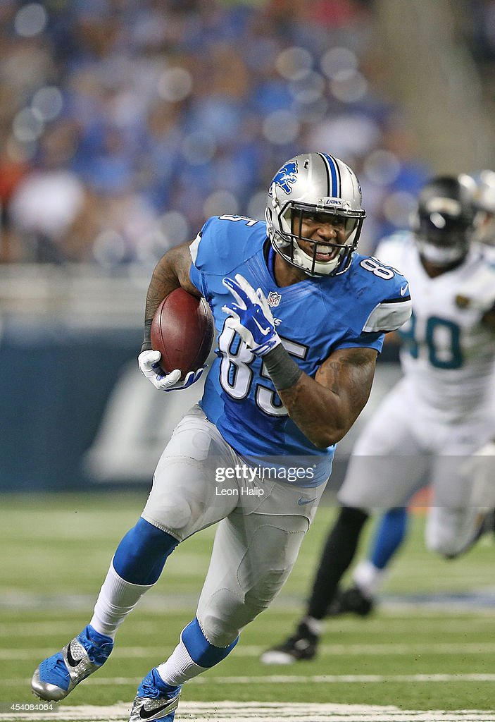 Eric Baron #85 runs for a first down during the first half of the preseason game against the Jacksonville Jaguars at Ford Field on August 22, 2014 in Detroit, Michigan. The Lions defeated the Jaguars 13-12.