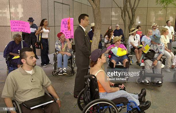 Eric Bauman assistant to California Governor Gray Davis stands waiting June 13 2000 to defend the governor to demonstrators protesting the state of...