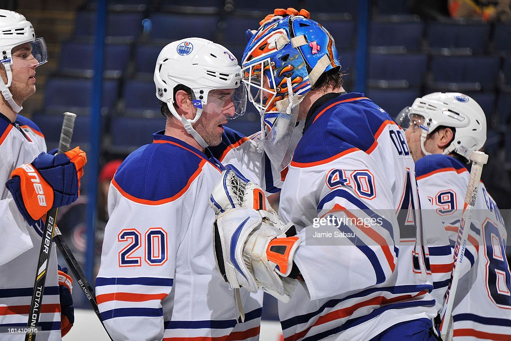 Eric Belanger #20 of the Edmonton Oilers congratulates goaltender Devan Dubnyk #40 of the Edmonton Oilers after Dubnyk posted 39 saves in Edmonton's 3-1 win over the Columbus Blue Jackets on February 10, 2013 at Nationwide Arena in Columbus, Ohio.