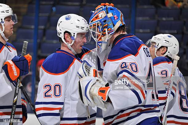 Eric Belanger of the Edmonton Oilers congratulates goaltender Devan Dubnyk of the Edmonton Oilers after Dubnyk posted 39 saves in Edmonton's 31 win...