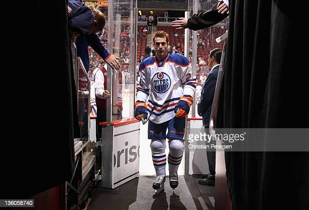 Eric Belanger of the Edmonton Oilers leaves the ice following warm ups to the NHL game against the Phoenix Coyotes at Jobingcom Arena on December 15...