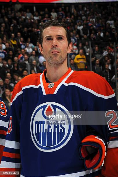 Eric Belanger of the Edmonton Oilers lines up for the singing of the national anthem prior to the home opener at Rexall Place on January 22 2013 in...
