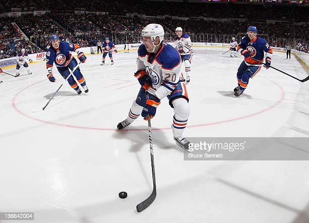 Eric Belanger of the Edmonton Oilers skates against the New York Islanders at the Nassau Veterans Memorial Coliseum on December 31 2011 in Uniondale...