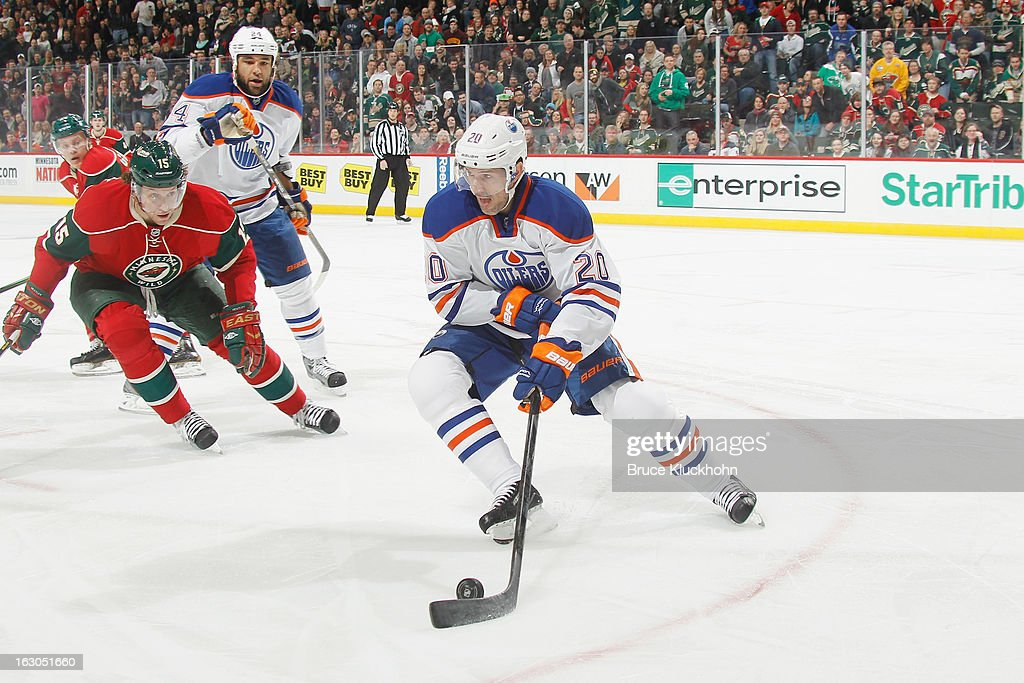 <a gi-track='captionPersonalityLinkClicked' href=/galleries/search?phrase=Eric+Belanger&family=editorial&specificpeople=206465 ng-click='$event.stopPropagation()'>Eric Belanger</a> #20 of the Edmonton Oilers skates with the puck while <a gi-track='captionPersonalityLinkClicked' href=/galleries/search?phrase=Dany+Heatley&family=editorial&specificpeople=202142 ng-click='$event.stopPropagation()'>Dany Heatley</a> #15 of the Minnesota Wild defends during the game on March 3, 2013 at the Xcel Energy Center in Saint Paul, Minnesota.