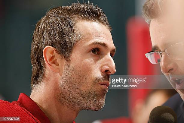 Eric Belanger of the Phoenix Coyotes is interviewed prior to the game against his former team the Minnesota Wild at the Xcel Energy Center on...