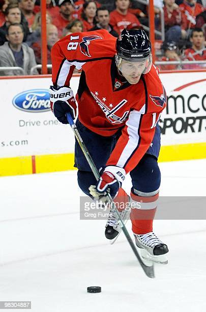 Eric Belanger of the Washington Capitals handles the puck against the Calgary Flames at the Verizon Center on March 28 2010 in Washington DC