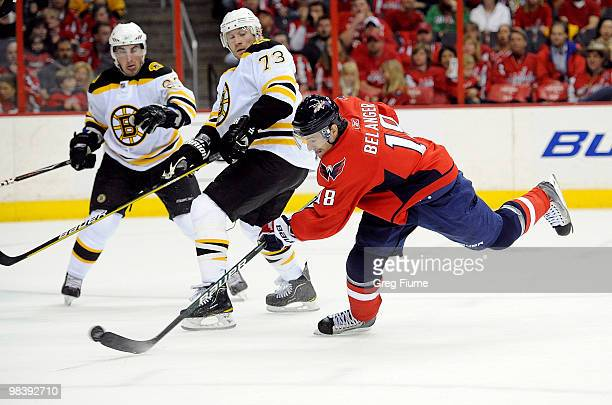 Eric Belanger of the Washington Capitals shoots and scores in the first period against the Boston Bruins at the Verizon Center on April 11 2010 in...