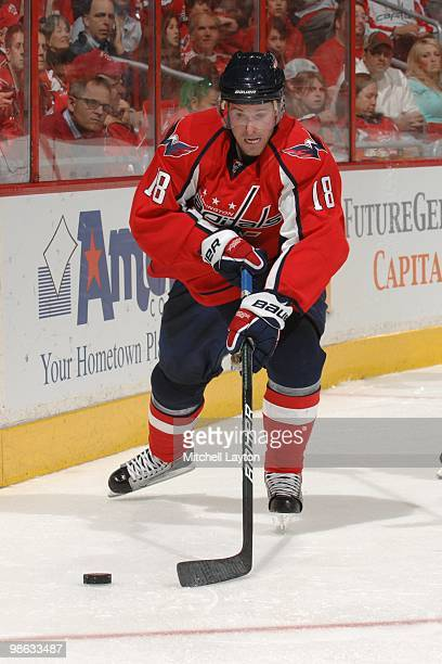 Eric Belanger of the Washington Capitals skates with the puck against the Montreal Canadiens during Game One of the Eastern Conference Quarterfinals...