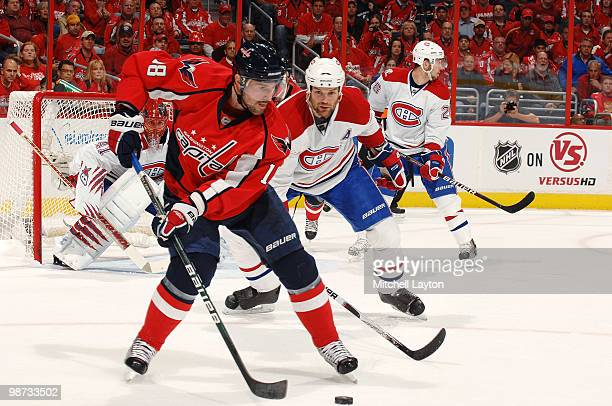 Eric Belanger of the Washington Capitals skates with the puck against the Montreal Canadiens during Game Seven of the Eastern Conference...
