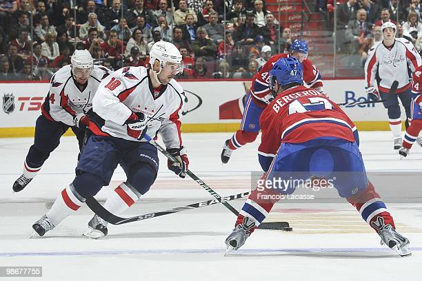 Eric Belanger of the Washington Capitals skates with the puck in front of MarcAndre Bergeron of Montreal Canadiens in Game Four of the Eastern...