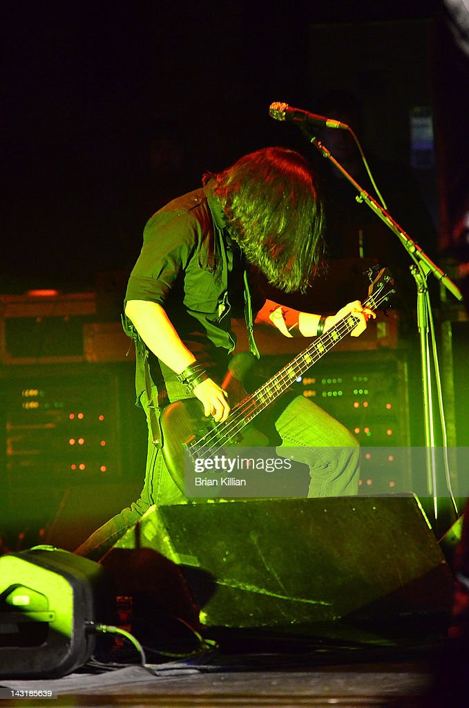 Eric Bergmann, bass player for the band Eve to Adam performs at the Beacon Theatre on April 20, 2012 in New York City.