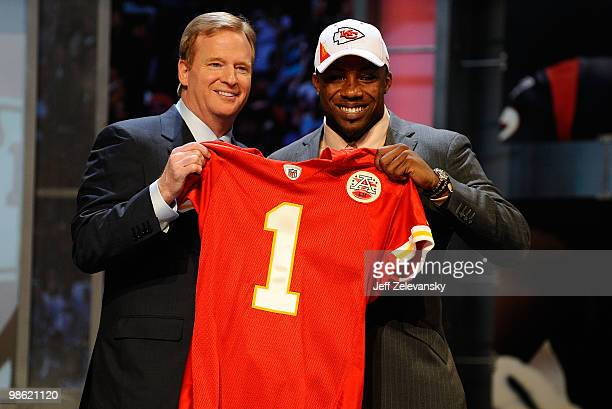 Eric Berry from the Tennessee Volunteers poses with NFL Commissioner Roger Goodell as they hold a Kansas City Chiefs jersey after Chiefs selected...