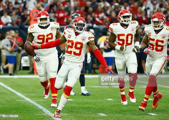 Eric Berry of the Kansas City Chiefs celebrates his first quarter interception against the Houston Texans during the AFC Wild Card Playoff game at...