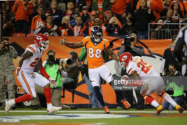 Eric Berry of the Kansas City Chiefs intercepts a pass in the endzone from quarterback Brock Osweiler of the Denver Broncos intended for Demaryius...