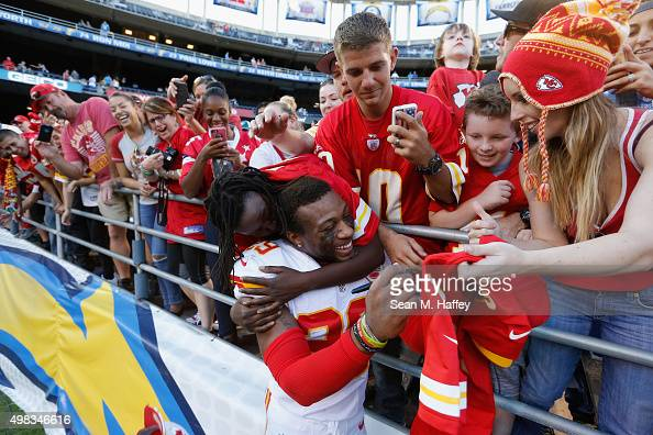 Eric Berry of the Kansas City Chiefs is hugged by fans at the end of game against the San Diego Chargers at Qualcomm Stadium on November 22 2015 in...