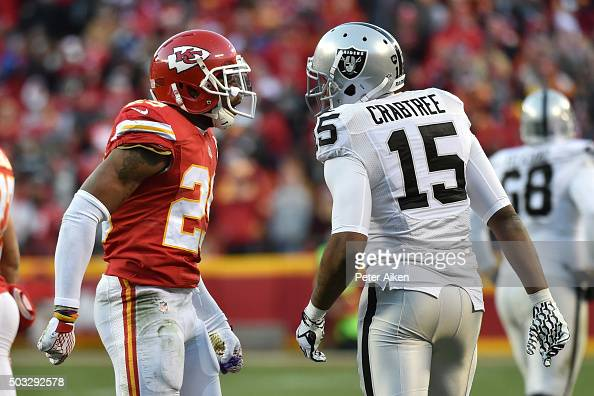 Eric Berry of the Kansas City Chiefs jaws with Michael Crabtree of the Oakland Raiders in a heated rivalry game at Arrowhead Stadium during the third...