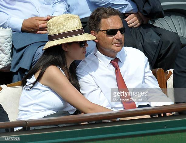 Eric Besson and his wife Yasmine Tordjman attend the French open at Roland Garros on June 5 2011 in Paris France