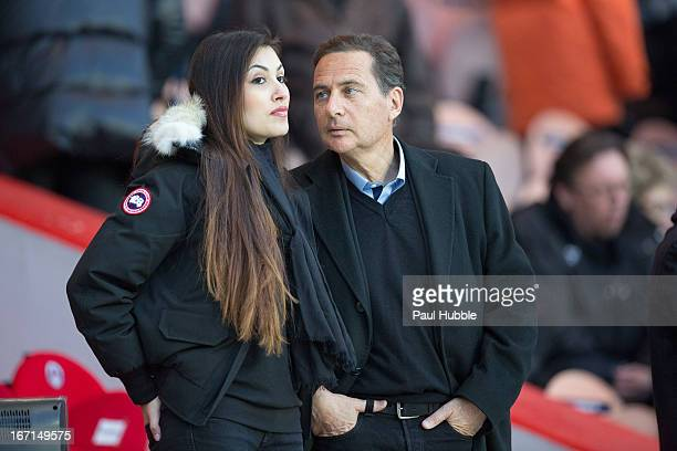 Eric Besson and Yasmine Tordjman are seen during the Ligue 1 match between Paris Saint Germain and OGC Nice at Parc des Princes on April 21 2013 in...
