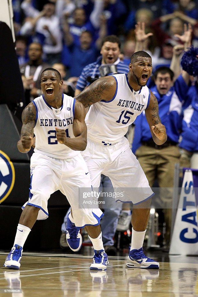 Eric Bledsoe #24 and DeMarcus Cousins #15 of the Kentucky Wildcats celebrates after Cousins made a 2-point basket at the end of regulation to tie the game and send it to overtime against the Mississippi State Bulldogs during the final of the SEC Men's Basketball Tournament at the Bridgestone Arena on March 14, 2010 in Nashville, Tennessee.
