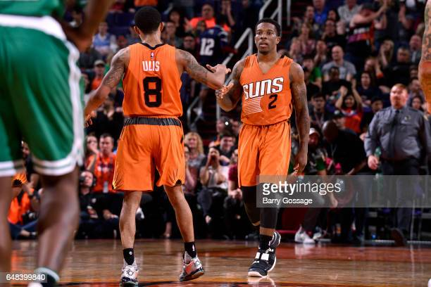 Eric Bledsoe and Tyler Ulis of the Phoenix Suns high five each other during the game against the Boston Celtics on March 5 2017 at US Airways Center...