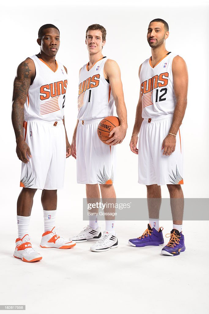 Eric Bledsoe #2, Goran Dragic #1, and Kendall Marshall #12 of the Phoenix Suns pose for a portrait on Media Day on September 30, 2013 at U.S. Airways Center in Phoenix, Arizona.