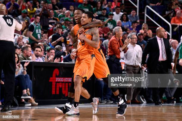 Eric Bledsoe hugs his teammate Tyler Ulis of the Phoenix Suns during the game against the Boston Celtics on March 5 2017 at US Airways Center in...