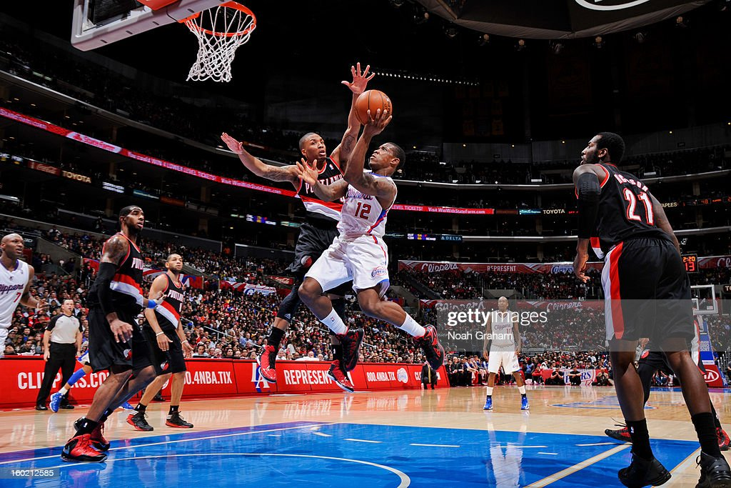 Eric Bledsoe #12 of the Los Angeles Clippers attempts a layup against Damian Lillard #0 of the Portland Trail Blazers at Staples Center on January 27, 2013 in Los Angeles, California.