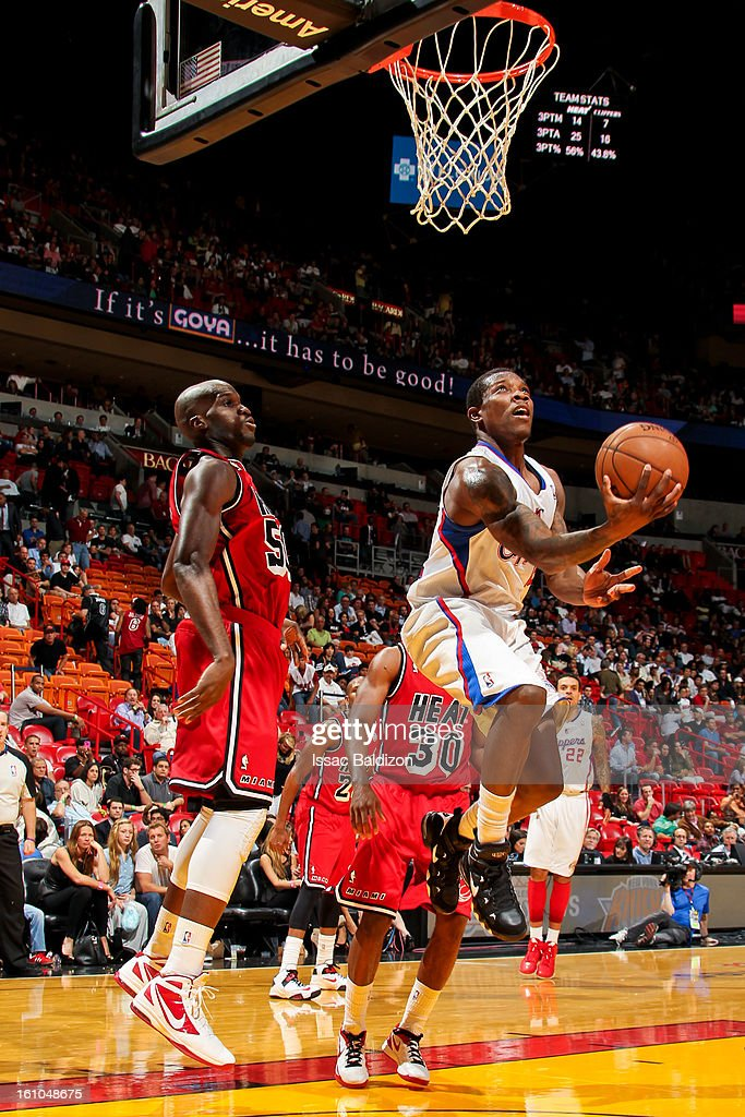 Eric Bledsoe #12 of the Los Angeles Clippers attempts a reverse layup against Joel Anthony #50 of the Miami Heat on February 8, 2013 at American Airlines Arena in Miami, Florida.