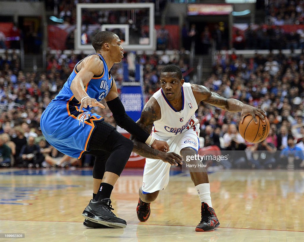 Eric Bledsoe #12 of the Los Angeles Clippers dribbles in front of Russell Westbrook #0 of the Oklahoma City Thunder during a 109-97 Thunder win at Staples Center on January 22, 2013 in Los Angeles, California.