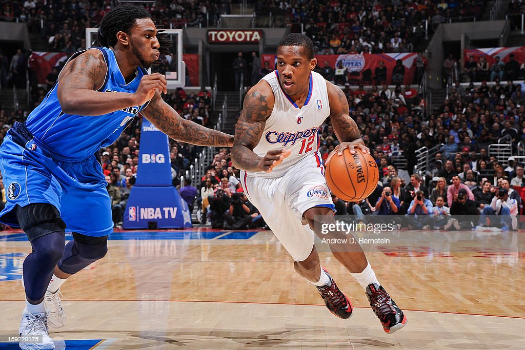 Eric Bledsoe #12 of the Los Angeles Clippers drives against Jae Crowder #9 of the Dallas Mavericks at Staples Center on January 9, 2013 in Los Angeles, California.