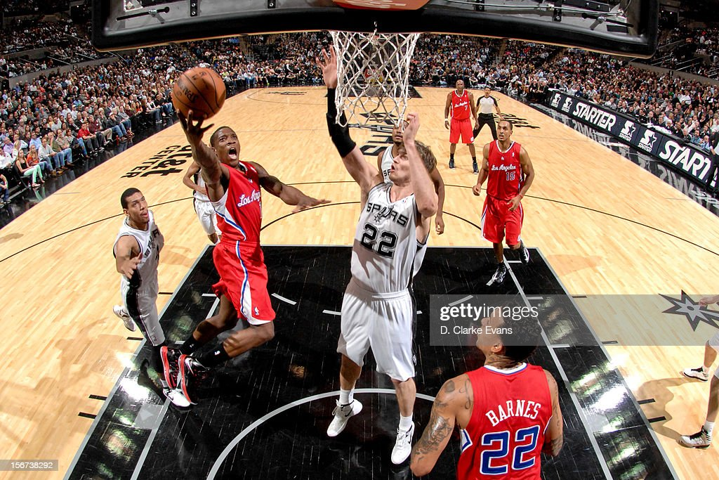 Eric Bledsoe #12 of the Los Angeles Clippers drives to the basket against Tiago Splitter #22 of the San Antonio Spurs on November 19, 2012 at the AT&T Center in San Antonio, Texas.