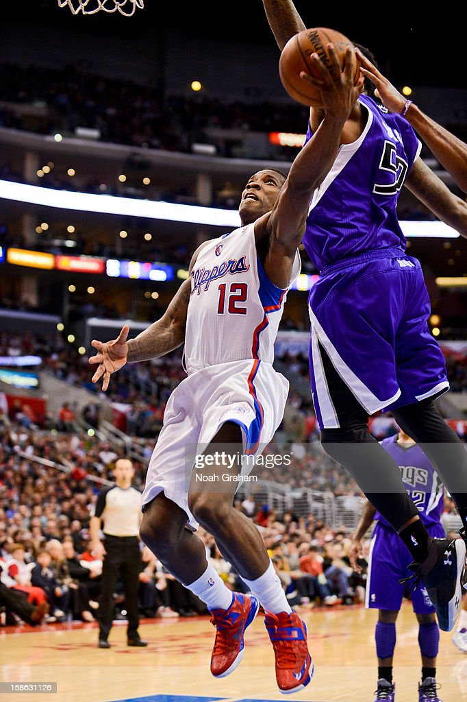 Eric Bledsoe #12 of the Los Angeles Clippers drives to the basket against the Sacramento Kings at Staples Center on December 21, 2012 in Los Angeles, California.