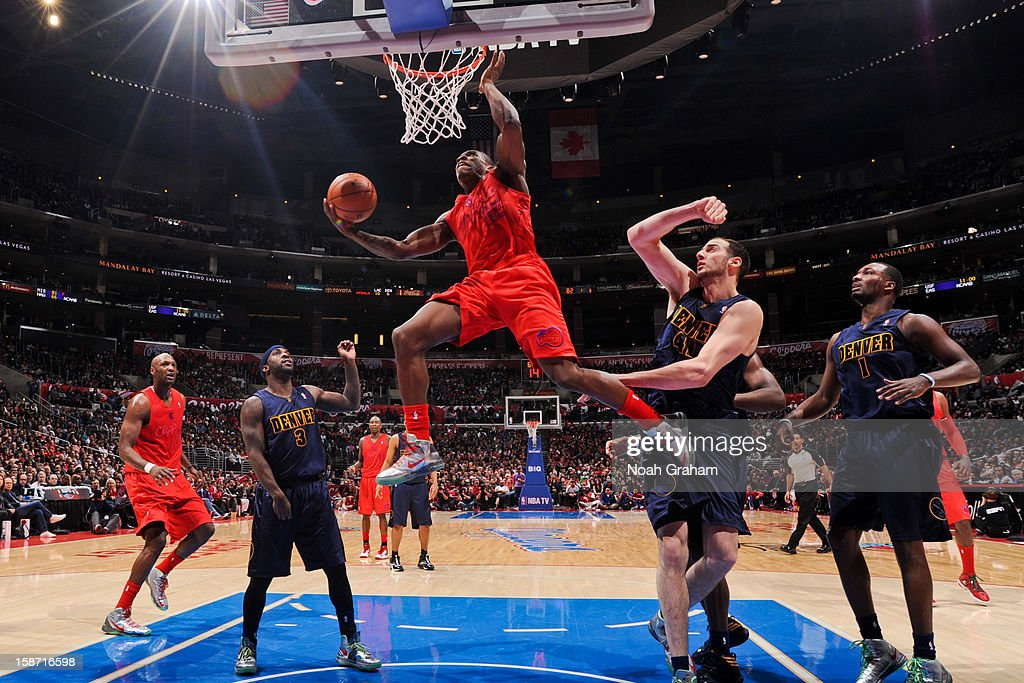 <a gi-track='captionPersonalityLinkClicked' href=/galleries/search?phrase=Eric+Bledsoe&family=editorial&specificpeople=6480906 ng-click='$event.stopPropagation()'>Eric Bledsoe</a> #12 of the Los Angeles Clippers drives to the basket against <a gi-track='captionPersonalityLinkClicked' href=/galleries/search?phrase=Kosta+Koufos&family=editorial&specificpeople=4216032 ng-click='$event.stopPropagation()'>Kosta Koufos</a> #41 and <a gi-track='captionPersonalityLinkClicked' href=/galleries/search?phrase=Ty+Lawson&family=editorial&specificpeople=4024882 ng-click='$event.stopPropagation()'>Ty Lawson</a> #3 of the Denver Nuggets during a Christmas Day game at Staples Center on December 25, 2012 in Los Angeles, California.