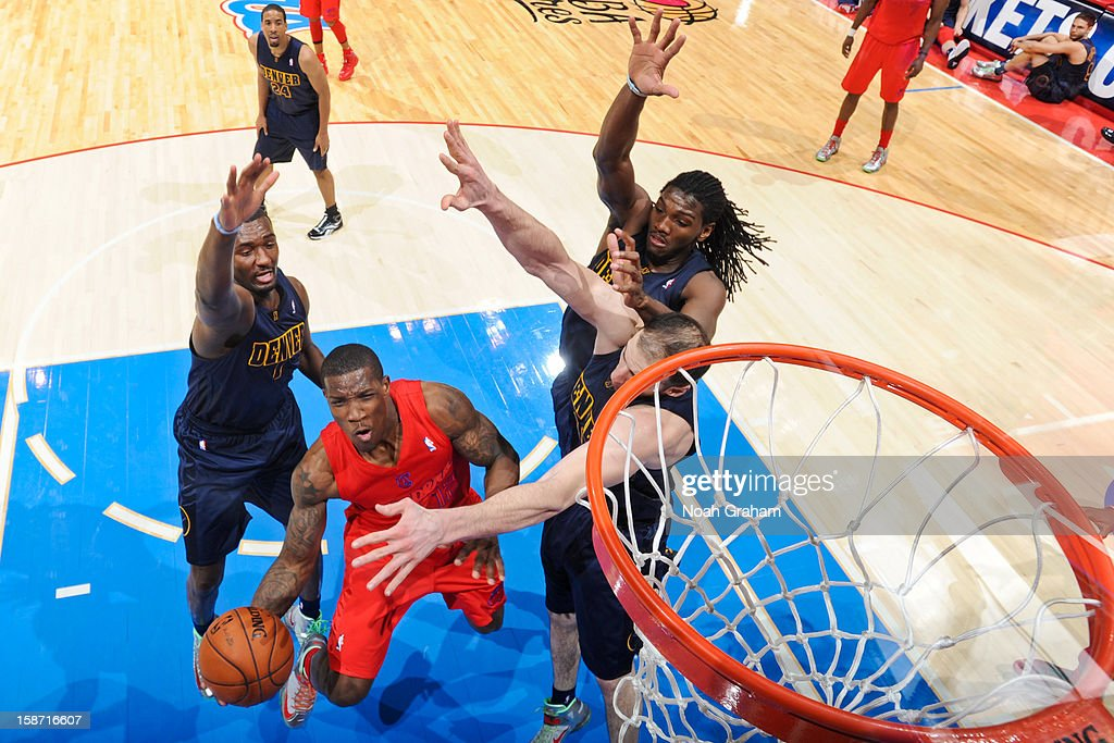 Eric Bledsoe #12 of the Los Angeles Clippers drives to the basket against Kosta Koufos #41, Kenneth Faried #35, and Anthony Randolph #15 of the Denver Nuggets during a Christmas Day game at Staples Center on December 25, 2012 in Los Angeles, California.